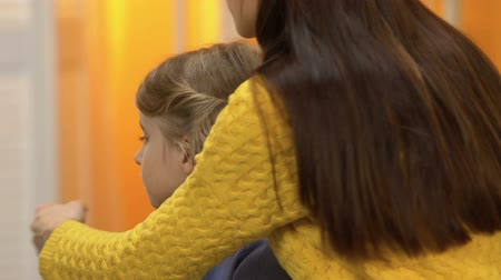 babysitter : Preschool offended girl turning away from lady, mommy hugging, fixing conflict