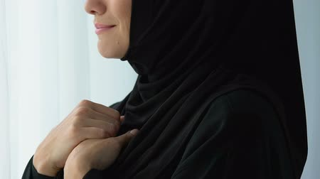 smutny : Unhappy muslim woman looking in window and crying, watching husband cheating
