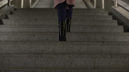 high heeled shoe : Female in fashionable shiny high-heel boots going upstairs, footwear quality Stock Footage