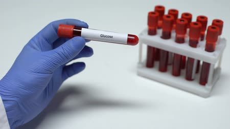 glicose : Glucose, doctor showing blood sample in tube, lab research, health checkup Stock Footage