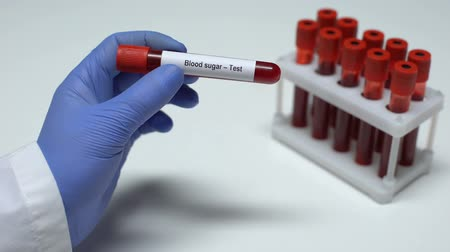 glicose : Blood sugar, doctor showing blood sample in tube, lab research, health checkup Stock Footage