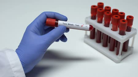 dose : Negative Toxic Metals test, doctor showing blood sample in tube, lab research