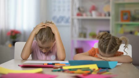 after school : Tired children falling asleep sitting at desk, exhausting after-school education
