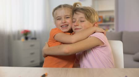 sarılmak : Little brother and sister hugging family togetherness, childish tender relations