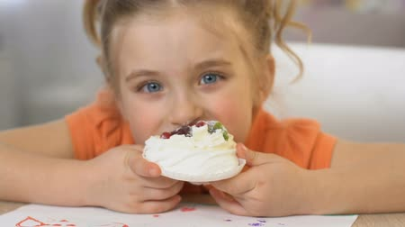 favori : Happy girl eating tasty cream cake, unhealthy nutrition, obesity risk, close up Stok Video