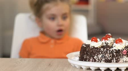 bot : Smiling girl looking with love at chocolate cake, sweets addiction, close up Stock Footage
