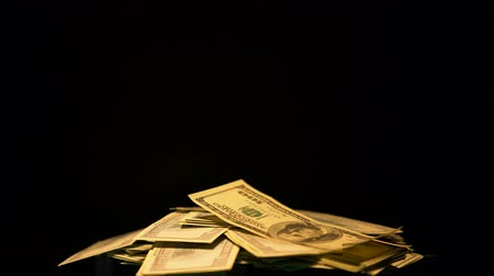 forgery : Pile of dollars on black background, illegal payments, offshore money laundering Stock Footage