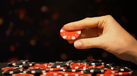 шансы : Female hand taking red chip, attracting luck in gambling, casino winning bets