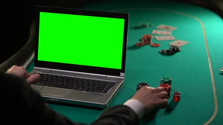 рулетка : Vip client paying poker bets online with gold card, gambling sites, green screen