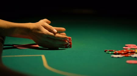 шансы : Poker player betting chips and keys to house, going all-in, gambling addiction