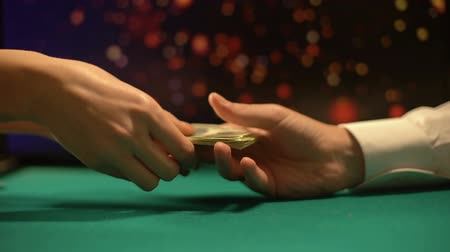 venality : Poker player giving money to female croupier, buying gambling chips, casino Stock Footage