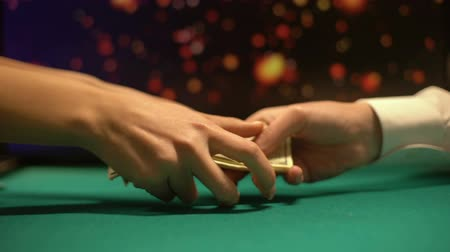 kombináció : Man giving female money, lights sparkling on background, illegal casino games