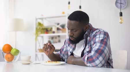 famished : Afro-American man refusing tasteless lunch, psychological problems, depression Stock Footage
