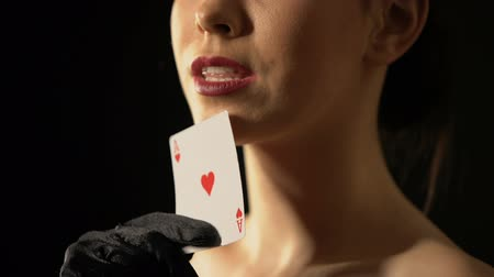 соблазнять : Elegant woman stroking her face with ace of hearts, fortune sign, gambling Стоковые видеозаписи