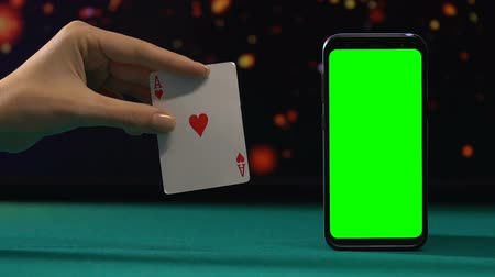 esély : Ace of hearts near green screen smartphone, winning combination, online casino