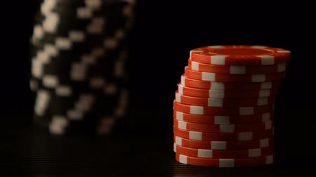 stacks : Female hands putting poker chips on table, casino game bet, winning strategy Stock Footage