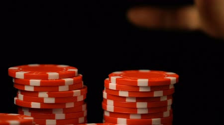 croupier : Woman putting poker chip in row, luxury casino club, gambling addiction, luck