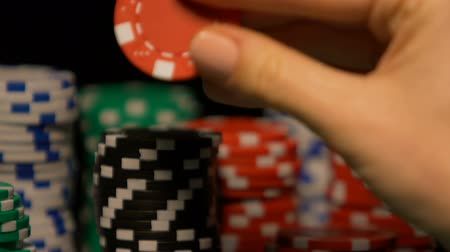 blackjack : Lady rotating poker chip in hand, pondering on strategy of game, fortune sign Stock Footage