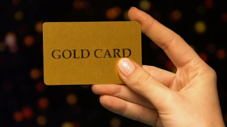 рулетка : Womans hand holding gold card, benefits for VIP clients in casino, gambling