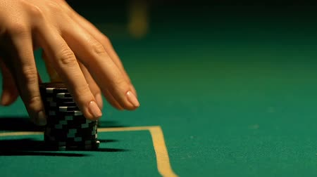покер : Lady putting poker chip rows on table, casino bet, chance of win and fortune