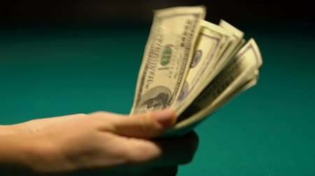 winnings : Woman counting dollars, poker gamer preparing for game, exchange money to chips