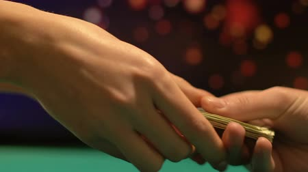 venality : Male poker player exchanging money for game, gambling addiction, casino club Stock Footage