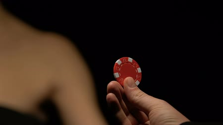 blackjack : Man giving woman poker chip, gambling seduction concept, inviting for game Stock Footage