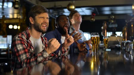 facepalm : Men watching sports match in pub, upset about losing of national team, facepalm Stock Footage