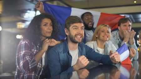 szlogen : Sport fans with French flag supporting national team, chanting slogan of victory