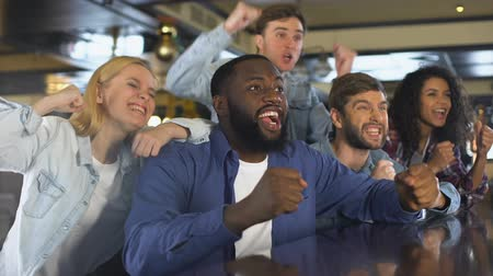 extremely : Multiracial group of fans supporting sport team, rejoicing winning goal, victory