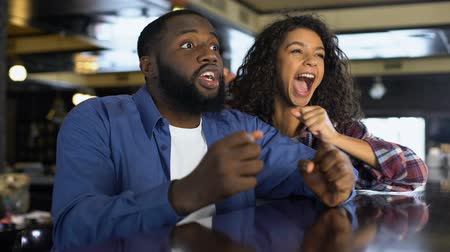 tifose : Multi-racial couple rooting for national team watching game, entertainment Filmati Stock