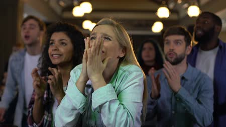 elections : Concentrated team supporters cheering for goal, sport fans entertainment, joy Stock Footage