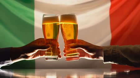 ale : Men clinking beer glasses, Italian flag on background, festival celebration Stock Footage