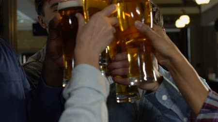 mout : Cheerful people laughing and clinking beer glasses, holiday celebration, relax Stockvideo