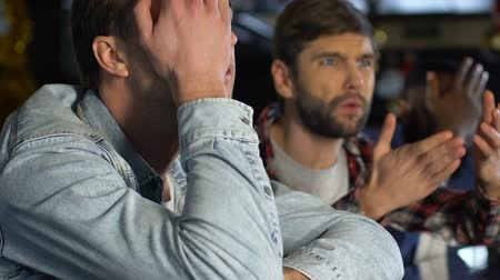 facepalm : Emotional male friends disappointed about favorite sports team losing game