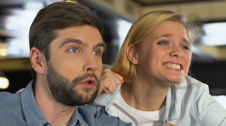 beisebol : Couple watching sport game in pub, disappointed about favorite team losing match Stock Footage