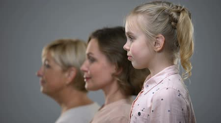 внучка : Little girl, adult woman and senior lady side view, family generations, future