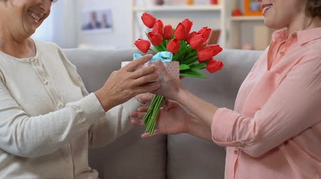 感謝の気持ち : Colleague giving presents to friend on International Women Day, spring holiday 動画素材