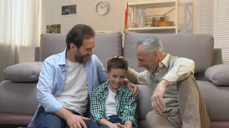 sincerely : Father and son spending pastime, enjoying visit to grandfather, slow-motion