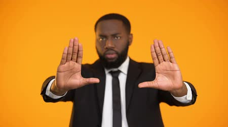 charisma : Afro-american man in business suit making stop gesture, no racism and inequality Stock Footage