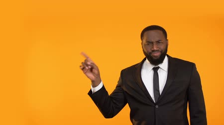charisma : Fashionable black man in business suit making dancing movements, place for ad Stock Footage