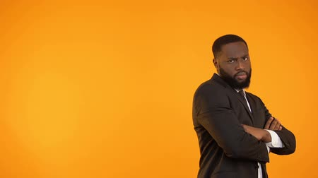 charisma : Funny black guy in formalwear dancing, isolated on orange background, template