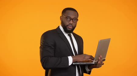 charisma : Busy african-american male in suit working on laptop, career growth, business