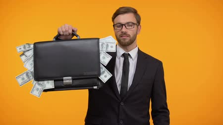 zsák : Male showing briefcase with money and doing ok gesture, payday lending service