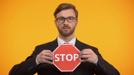 запретить : Male showing stop sign, shaking head to reject, employees rights protection