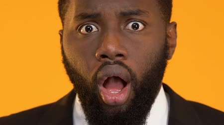 astonishment : African-American man in suit astonished by bad news, failed business project
