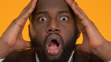 удивительный : Shocked black business man holding head, deadline overdue, project management