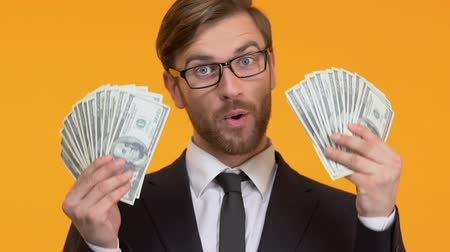доллар : Happy man bragging with big sum of cash, lottery or casino winning, close-up