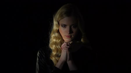 fiel : Female sinner praying in dark room, looking for forgiveness, faith and belief