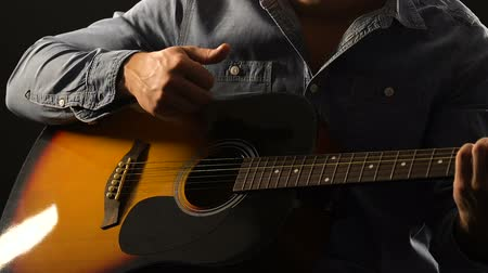 dizgi : Musician playing acoustic guitar closeup, enjoying live session on performance Stok Video